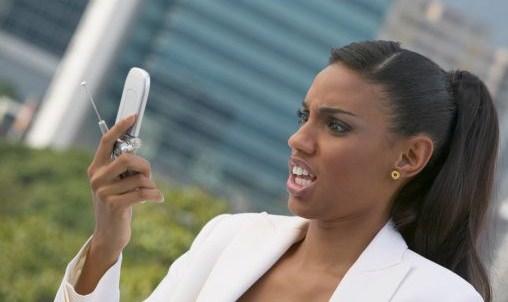 black-woman-looking-at-cell-phone.jpg